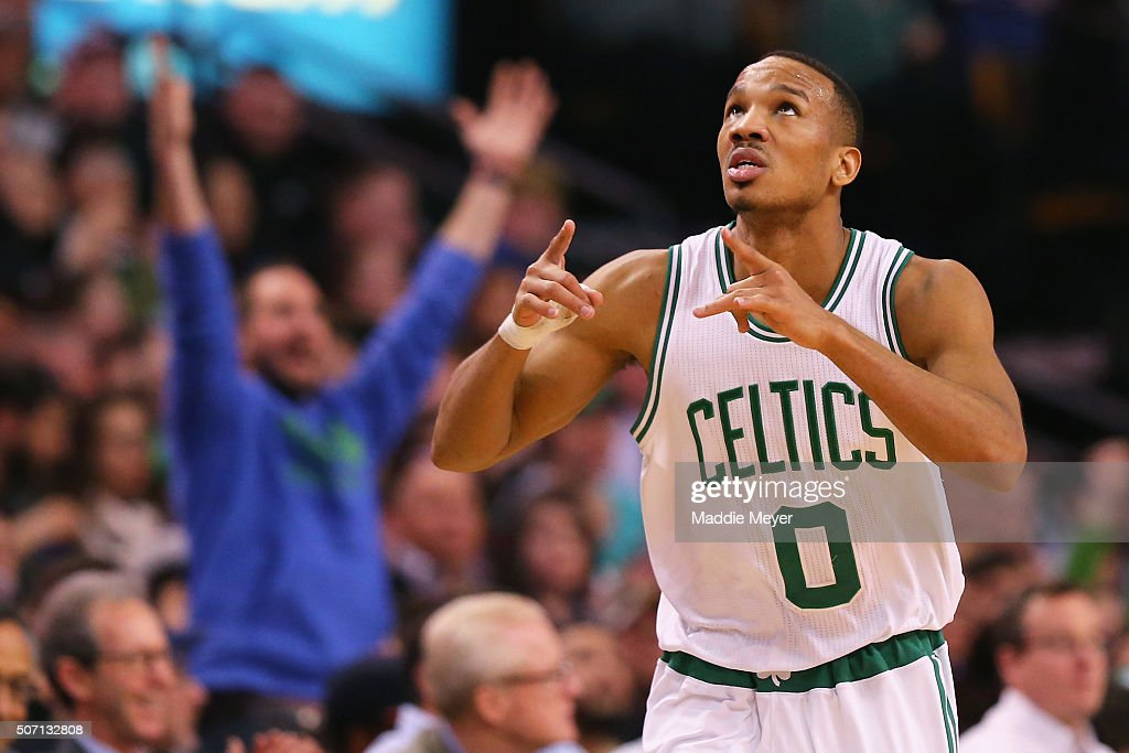 Avery Bradley of the Boston Celtics celebrates after hitting a three point shot against the Denver Nuggets during the second quarter at TD Garden on...