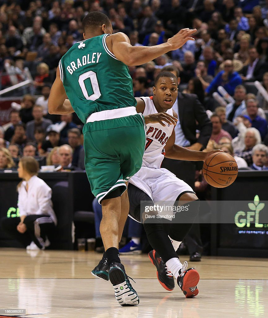 Avery Bradley #0 of the Boston Celtics defends against Kyle Lowry #7 of the Toronto Raptors as he drives to the basket during their NBA game at the Air Canada Centre on October 30, 2013 in Saint John, New Brunswick, Canada.