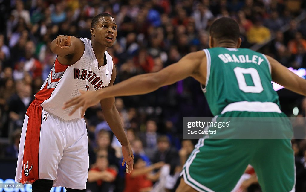 Avery Bradley #0 of the Boston Celtics defends as Kyle Lowry #7 of the Toronto Raptors gives direction to his teammates during their NBA game at the Air Canada Centre on October 30, 2013 in Toronto, Ontario, Canada.