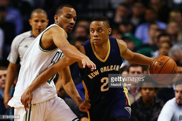 Avery Bradley of the Boston Celtics defends Tim Frazier of the New Orleans Pelicans during the third quarter at TD Garden on April 6 2016 in Boston...