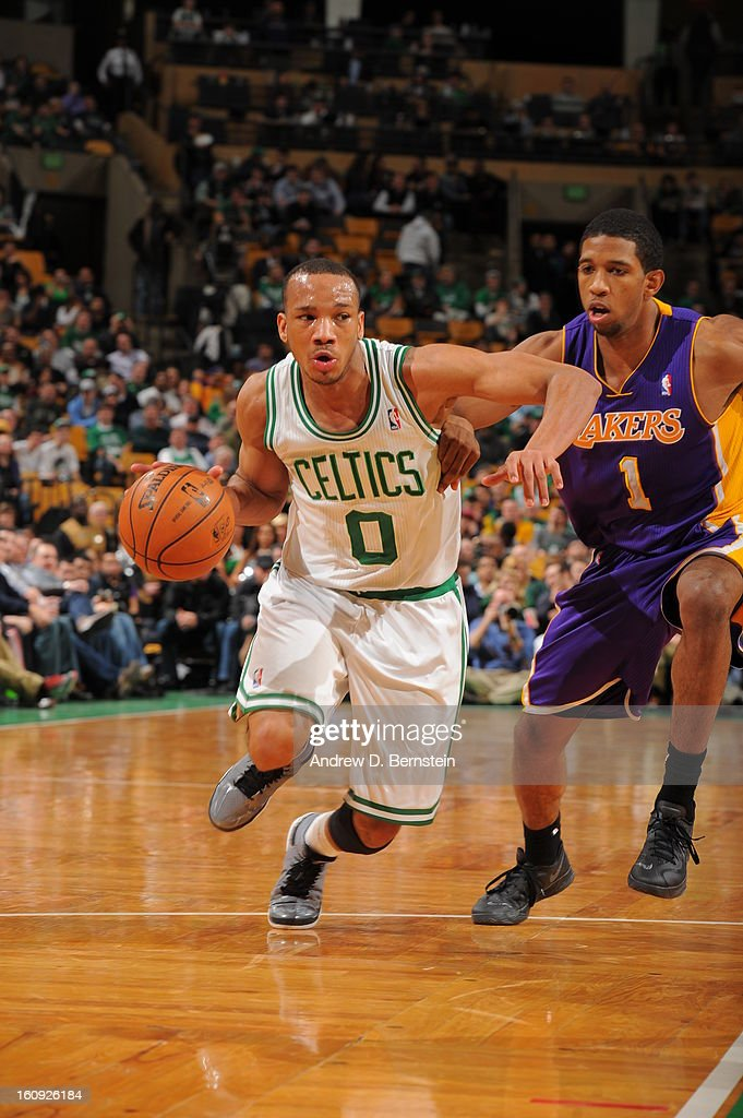 Avery Bradley #0 of the Boston Celtics drives past Darius Morris #1 of the Los Angeles Lakers on February 7, 2013 at the TD Garden in Boston, Massachusetts.