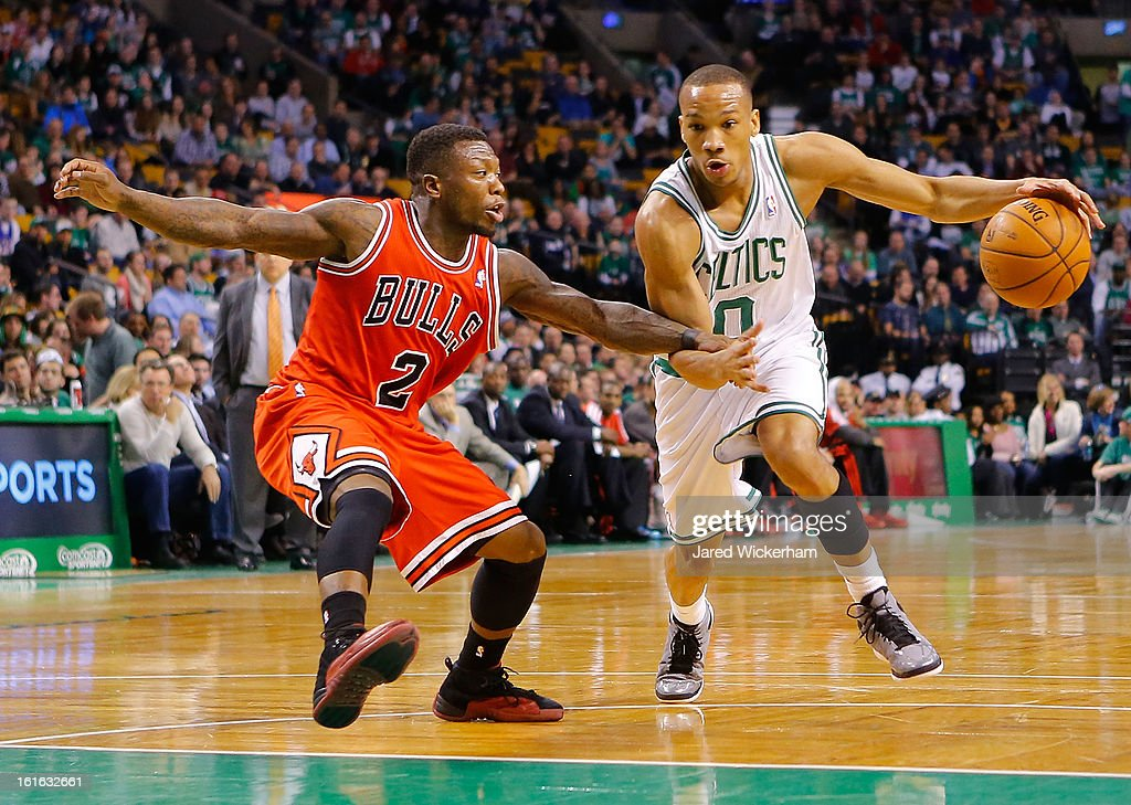 Avery Bradley #0 of the Boston Celtics drives to the basket against Nate Robinson #2 of the Chicago Bulls during the game on February 13, 2013 at TD Garden in Boston, Massachusetts.