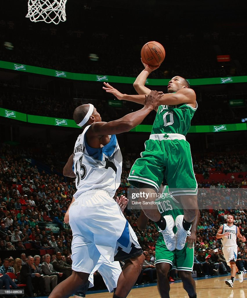 <a gi-track='captionPersonalityLinkClicked' href=/galleries/search?phrase=Avery+Bradley&family=editorial&specificpeople=5792051 ng-click='$event.stopPropagation()'>Avery Bradley</a> #0 of the Boston Celtics drives to the basket as <a gi-track='captionPersonalityLinkClicked' href=/galleries/search?phrase=Dante+Cunningham&family=editorial&specificpeople=683729 ng-click='$event.stopPropagation()'>Dante Cunningham</a> #33 of the Minnesota Timberwolves defends during their NBA pre-season game at the Bell Centre on October 20, 2013 in Montreal, Quebec, Canada.
