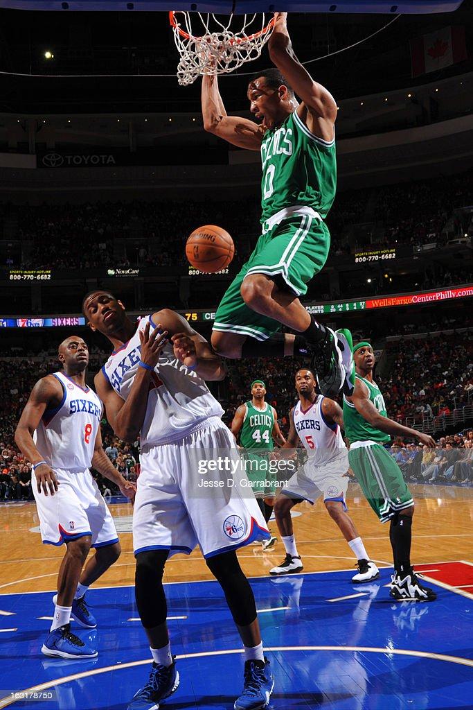Avery Bradley #0 of the Boston Celtics dunks against Thaddeus Young #21 of the Philadelphia 76ers on March 5, 2013 at the Wells Fargo Center in Philadelphia, Pennsylvania.