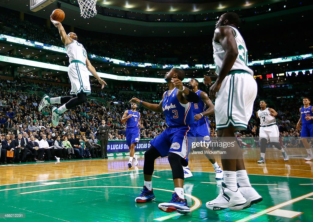 Avery Bradley #0 of the Boston Celtics dunks an alley-oop in the first quarter against the Los Angeles Clippers during the game at TD Garden on December 11, 2013 in Boston, Massachusetts.