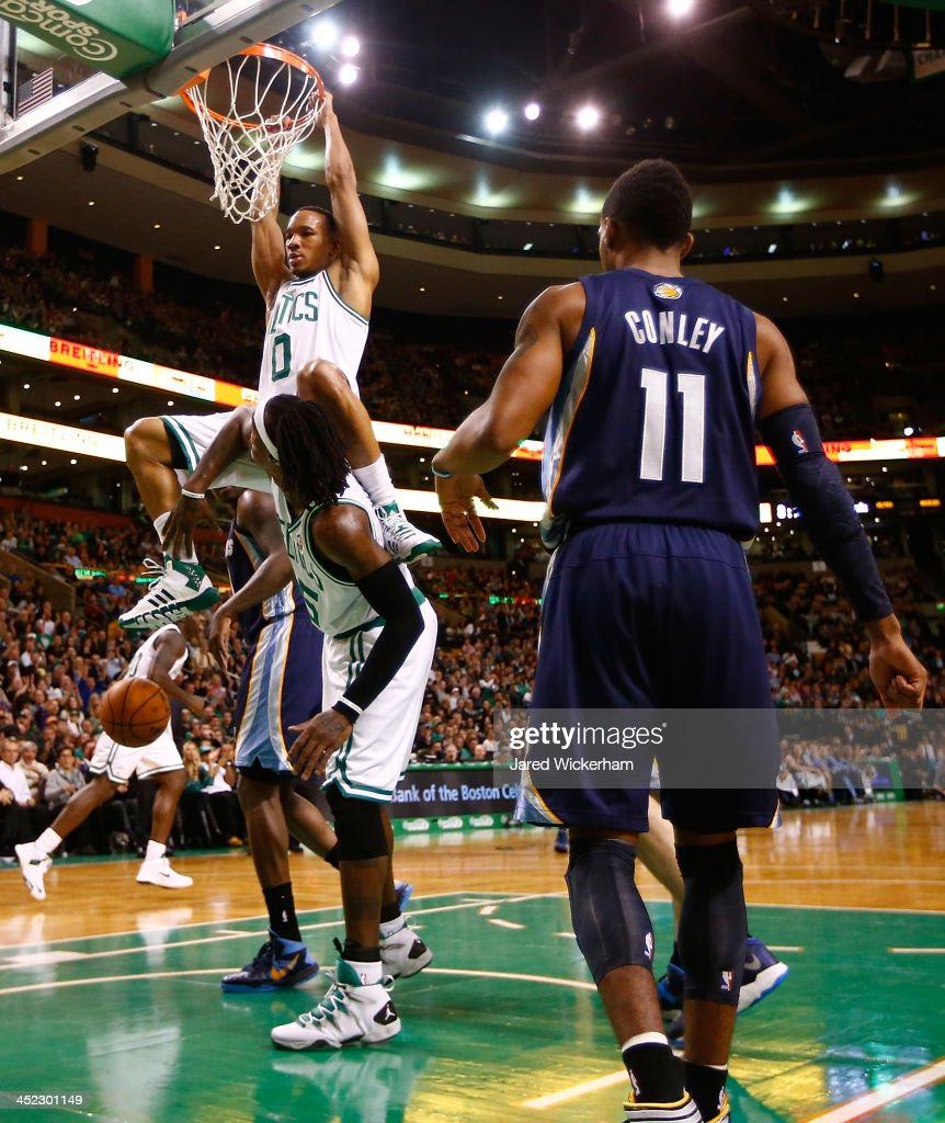 Avery Bradley #0 of the Boston Celtics dunks his rebound over teammate Gerald Wallace #45 in the second quarter against the Memphis Grizzlies during the game at TD Garden on November 27, 2013 in Boston, Massachusetts.
