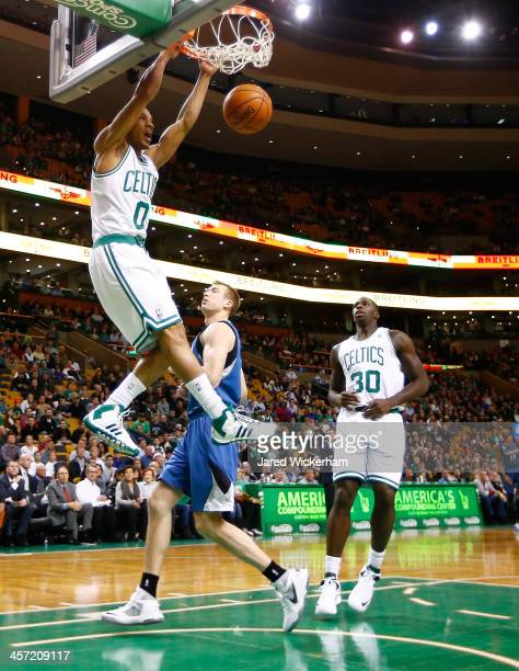 Avery Bradley of the Boston Celtics dunks the ball in front of Robbie Hummel of the Minnesota Timberwolves in the first quarter during the game at TD...