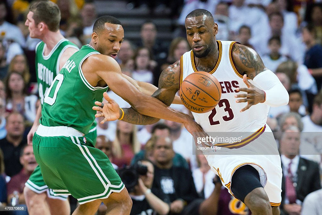<a gi-track='captionPersonalityLinkClicked' href=/galleries/search?phrase=Avery+Bradley&family=editorial&specificpeople=5792051 ng-click='$event.stopPropagation()'>Avery Bradley</a> #0 of the Boston Celtics fights for a loose ball with <a gi-track='captionPersonalityLinkClicked' href=/galleries/search?phrase=LeBron+James&family=editorial&specificpeople=201474 ng-click='$event.stopPropagation()'>LeBron James</a> #23 of the Cleveland Cavaliers in the first half during Game One in the Eastern Conference Quarterfinals of the 2015 NBA Playoffs 2015 at Quicken Loans Arena on April 19, 2015 in Cleveland, Ohio.