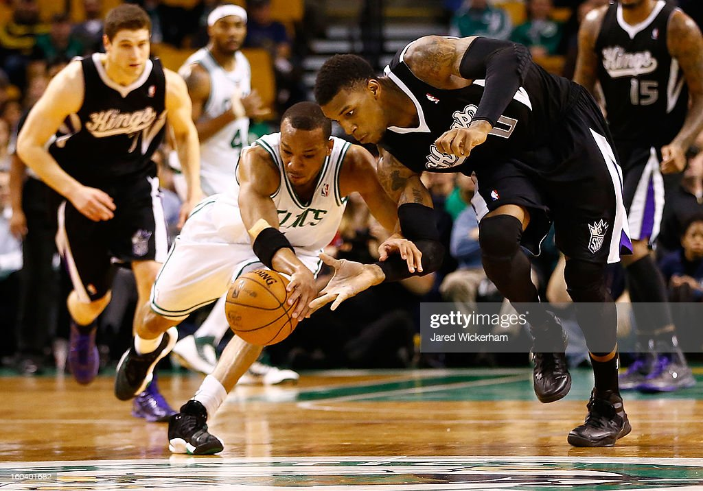Avery Bradley #0 of the Boston Celtics goes for a loose ball against Thomas Robinson #0 of the Sacramento Kings during the game on January 30, 2013 at TD Garden in Boston, Massachusetts.