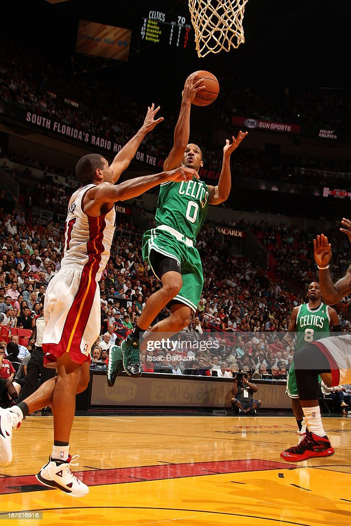 Avery Bradley #0 of the Boston Celtics goes to the basket against Shane Battier #31 of the Miami Heat on November 9, 2013 at American Airlines Arena in Miami, Florida.