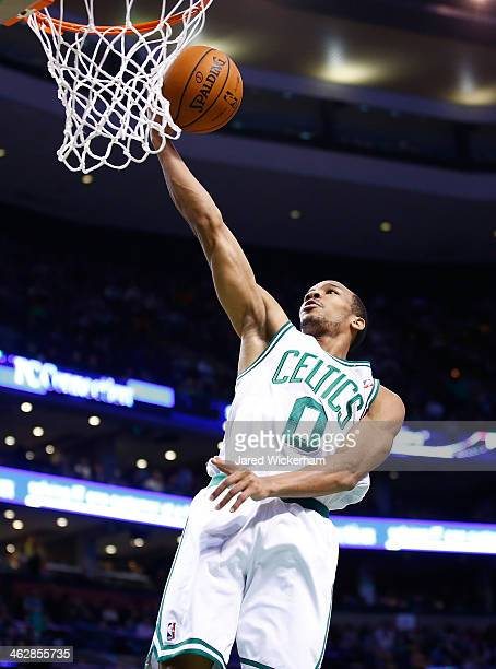 Avery Bradley of the Boston Celtics goes up for a layup against the Toronto Raptors during the game at TD Garden on January 15 2014 in Boston...