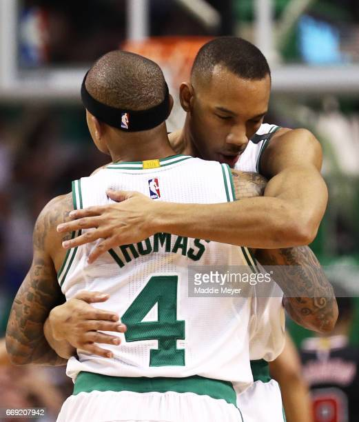 Avery Bradley of the Boston Celtics hugs Isaiah Thomas during the first quarter of Game One of the Eastern Conference Quarterfinals against the...