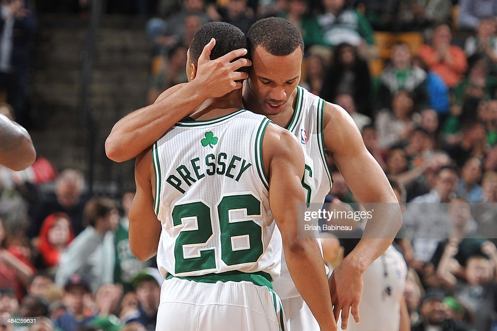 <a gi-track='captionPersonalityLinkClicked' href=/galleries/search?phrase=Avery+Bradley&family=editorial&specificpeople=5792051 ng-click='$event.stopPropagation()'>Avery Bradley</a> #0 of the Boston Celtics hugs team mates <a gi-track='captionPersonalityLinkClicked' href=/galleries/search?phrase=Phil+Pressey&family=editorial&specificpeople=7399881 ng-click='$event.stopPropagation()'>Phil Pressey</a> #26 after a play against the Charlotte Bobcats on April 11, 2014 at the TD Garden in Boston, Massachusetts.