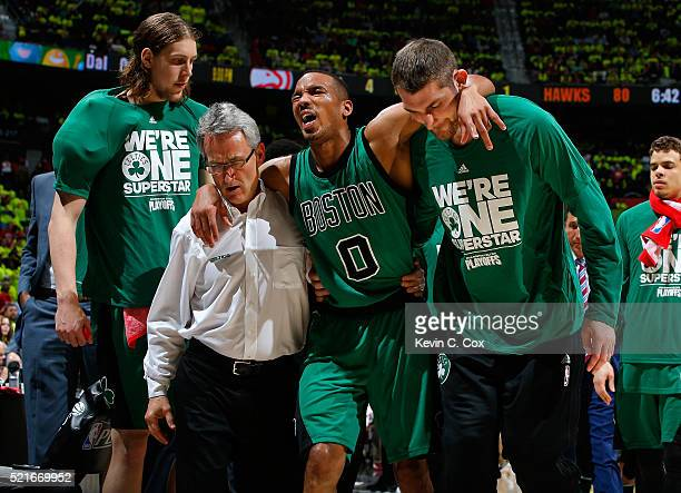 Avery Bradley of the Boston Celtics is assisted off the court after an injury against the Atlanta Hawks in Game One of the Eastern Conference...