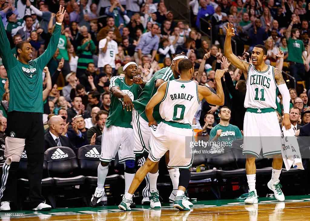 Avery Bradley #0 of the Boston Celtics is congratulated by teammates on the bench after making a three-point shot against the Phoenix Suns during the game on January 9, 2013 at TD Garden in Boston, Massachusetts.
