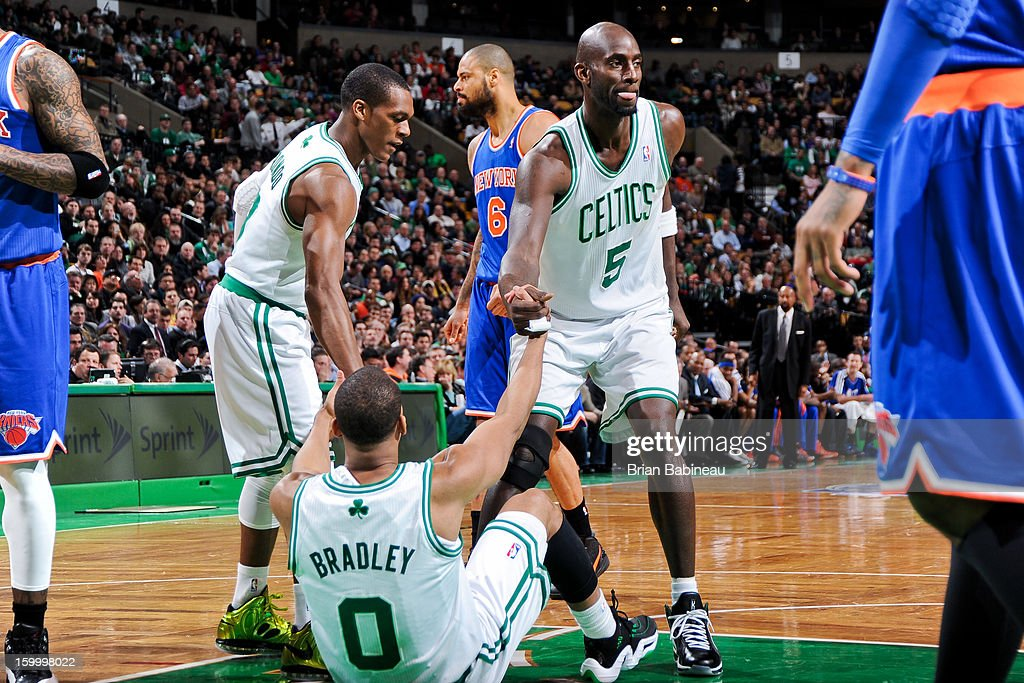 Avery Bradley #0 of the Boston Celtics is helped up by teammates Kevin Garnett #5 and Rajon Rondo #9 during a game against the New York Knicks on January 24, 2013 at the TD Garden in Boston, Massachusetts.