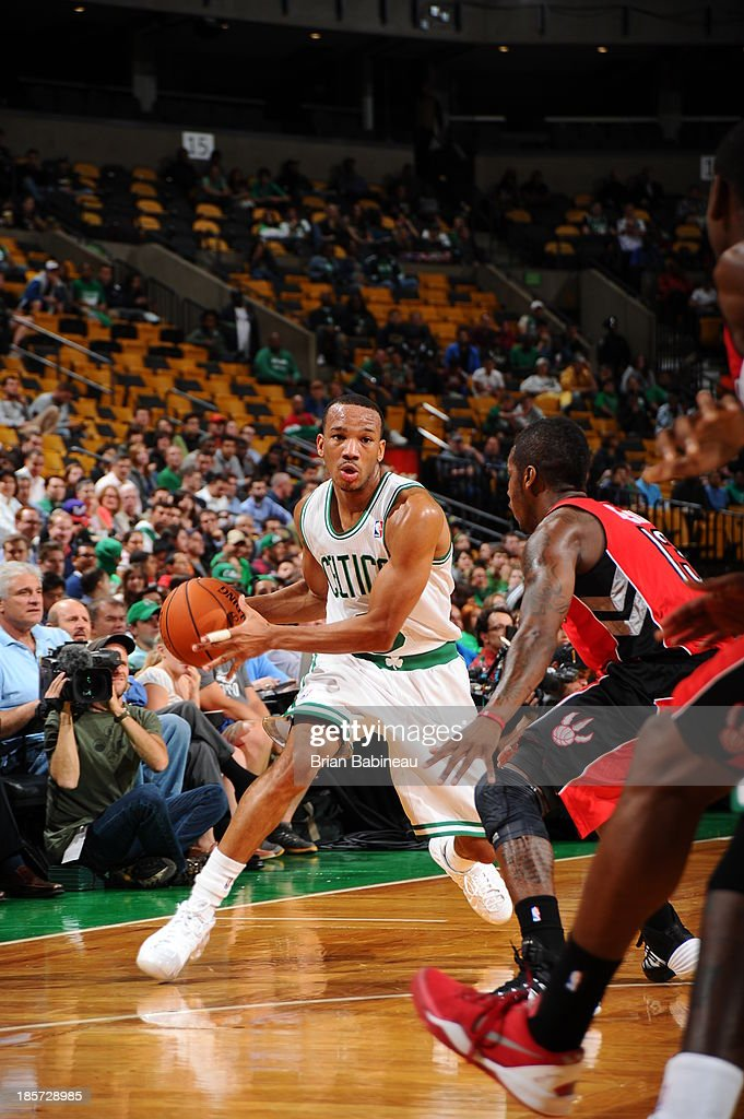 Avery Bradley #0 of the Boston Celtics passes the ball against the Toronto Raptors on October 7, 2013 at the TD Garden in Boston, Massachusetts.