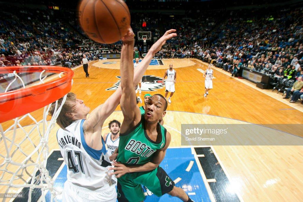 Avery Bradley #0 of the Boston Celtics rises for a dunk against Andrei Kirilenko #47 of the Minnesota Timberwolves on April 1, 2013 at Target Center in Minneapolis, Minnesota.