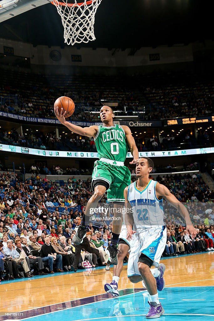 Avery Bradley #0 of the Boston Celtics shoots a layup against Brian Roberts #22 of the New Orleans Hornets on March 20, 2013 at the New Orleans Arena in New Orleans, Louisiana.