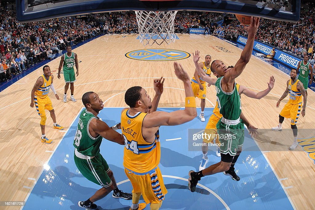 Avery Bradley #0 of the Boston Celtics shoots a layup against JaVale McGee #34 of the Denver Nuggets on February 19, 2013 at the Pepsi Center in Denver, Colorado.
