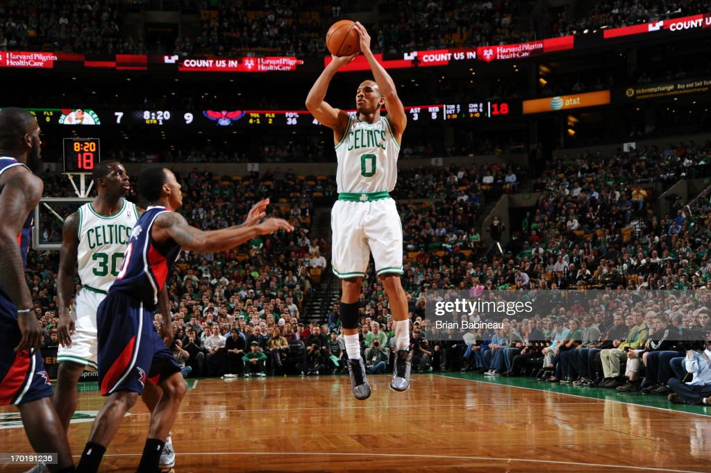 <a gi-track='captionPersonalityLinkClicked' href=/galleries/search?phrase=Avery+Bradley&family=editorial&specificpeople=5792051 ng-click='$event.stopPropagation()'>Avery Bradley</a> #0 of the Boston Celtics shoots against <a gi-track='captionPersonalityLinkClicked' href=/galleries/search?phrase=Jeff+Teague&family=editorial&specificpeople=4680498 ng-click='$event.stopPropagation()'>Jeff Teague</a> #0 of the Atlanta Hawks on March 29, 2013 at the TD Garden in Boston, Massachusetts.