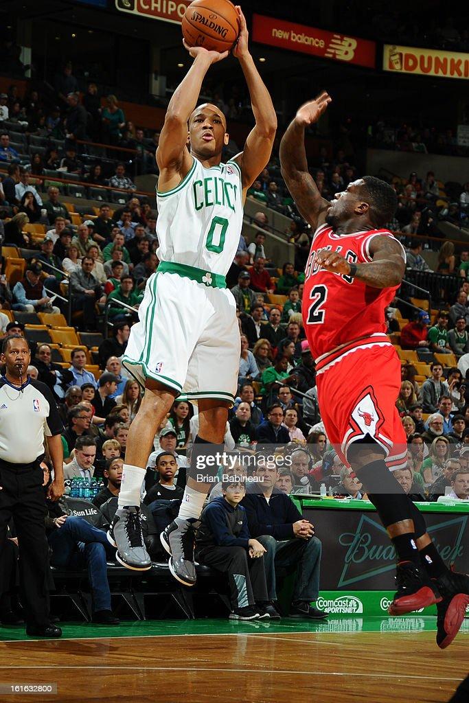Avery Bradley #0 of the Boston Celtics shoots against Nate Robinson #2 of the Chicago Bulls on February 13, 2013 at the TD Garden in Boston, Massachusetts.