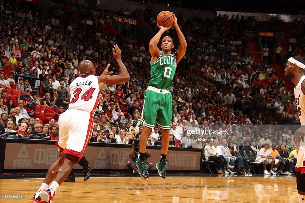 Avery Bradley #0 of the Boston Celtics shoots against Ray Allen #34 of the Miami Heat on November 9, 2013 at American Airlines Arena in Miami, Florida.