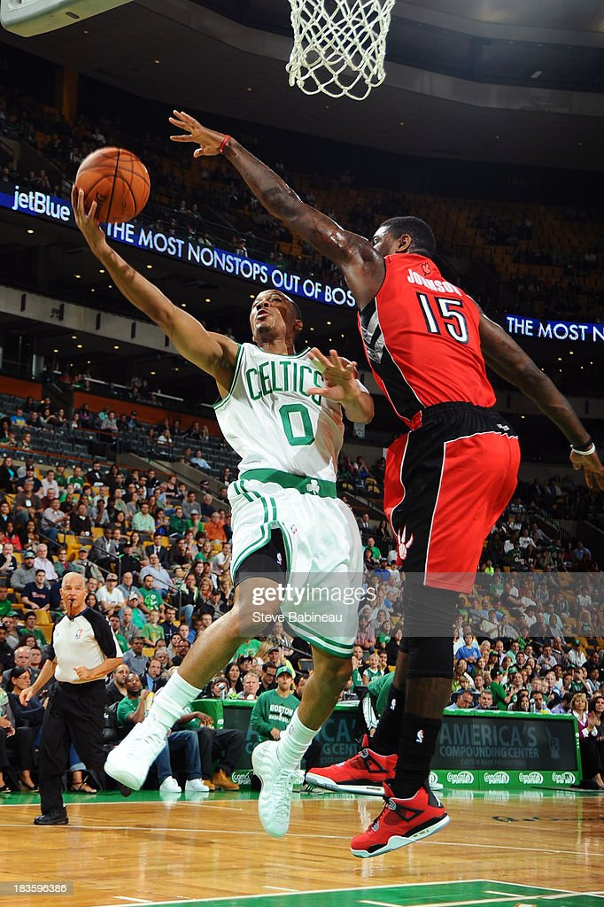 Avery Bradley #0 of the Boston Celtics shoots the ball against Amir Johnson #15 of the Toronto Raptors on October 7, 2013 at the TD Garden in Boston, Massachusetts.