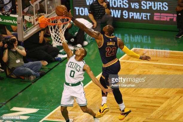 Avery Bradley of the Boston Celtics shoots the ball against LeBron James of the Cleveland Cavaliers in the first half during Game Two of the 2017 NBA...