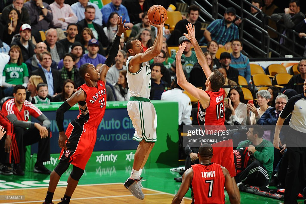 <a gi-track='captionPersonalityLinkClicked' href=/galleries/search?phrase=Avery+Bradley&family=editorial&specificpeople=5792051 ng-click='$event.stopPropagation()'>Avery Bradley</a> #0 of the Boston Celtics shoots the ball against Terrance Ross #31 and <a gi-track='captionPersonalityLinkClicked' href=/galleries/search?phrase=Steve+Novak&family=editorial&specificpeople=693015 ng-click='$event.stopPropagation()'>Steve Novak</a> #16 of the Toronto Raptors on January 15, 2014 at the TD Garden in Boston, Massachusetts.