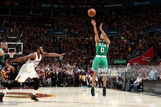 Avery Bradley of the Boston Celtics shoots the game winning threepoint shot during the game against the Cleveland Cavaliers in Game Three of the...