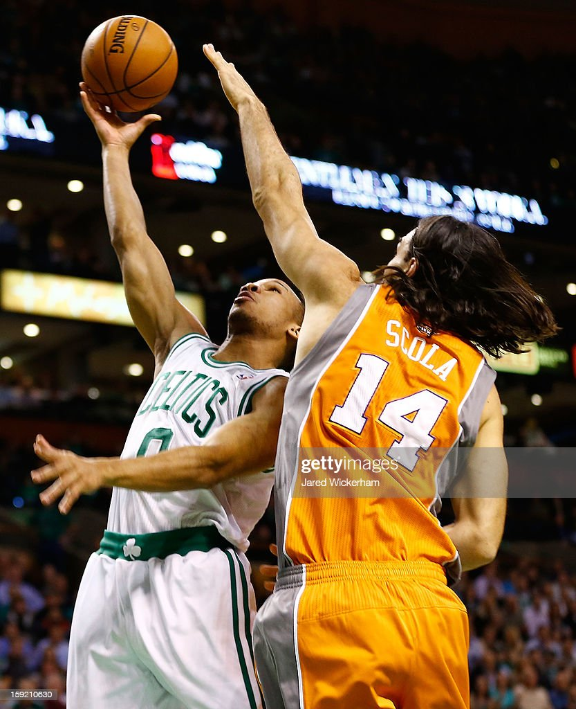 Avery Bradley #0 of the Boston Celtics takes a shot over Luis Scola #14 of the Phoenix Suns during the game on January 9, 2013 at TD Garden in Boston, Massachusetts.