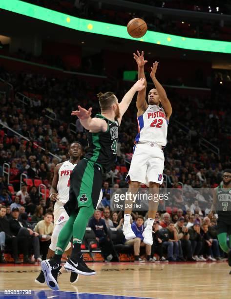 Avery Bradley of the Detroit Pistons shoots over Aron Baynes of the Boston Celtics at Little Caesars Arena on December 10 2017 in Detroit Michigan...