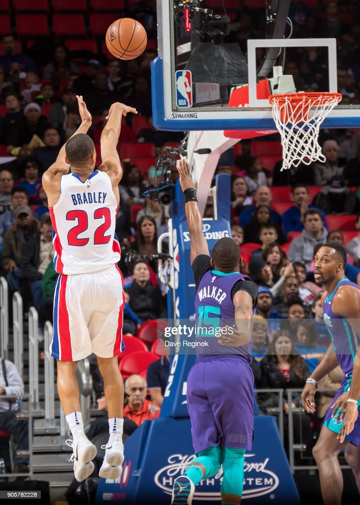 Avery Bradley #22 of the Detroit Pistons shoots the ball over Kemba Walker #15 of the Charlotte Hornets during the an NBA game at Little Caesars Arena on January 15, 2018 in Detroit, Michigan.