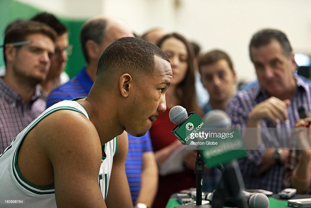 Avery Bradley ponders a question from reporters. The Boston Celtics held their Media Day at the team's training facility at HealthPoint. Players posed for promotional photos, did television promos, signed autographed memorabilia, and took questions from reporters.