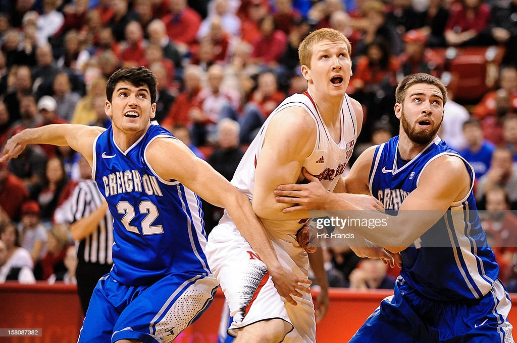 Avery Dingman #22 and Ethan Wragge #34 of the Creighton Bluejays work on Brandon Ubel #13 of the Nebraska Cornhuskers during their game at the Devaney Center on December 6, 2012 in Lincoln, Nebraska.