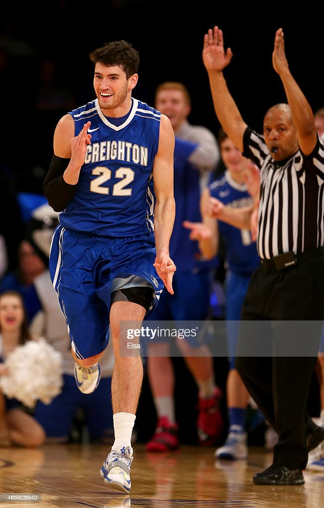 Avery Dingman of the Creighton Bluejays celebrates his three point shot in the second half against the DePaul Blue Demons during a first round game...