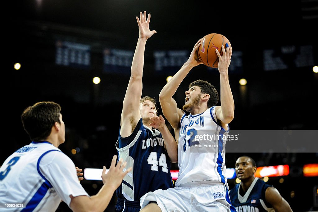 Avery Dingman #22 of the Creighton Bluejays drives to the hoop against Jeff Havenstein #44 of the Longwood Lancers during their game at CenturyLink Center on November 20, 2012 in Omaha, Nebraska.
