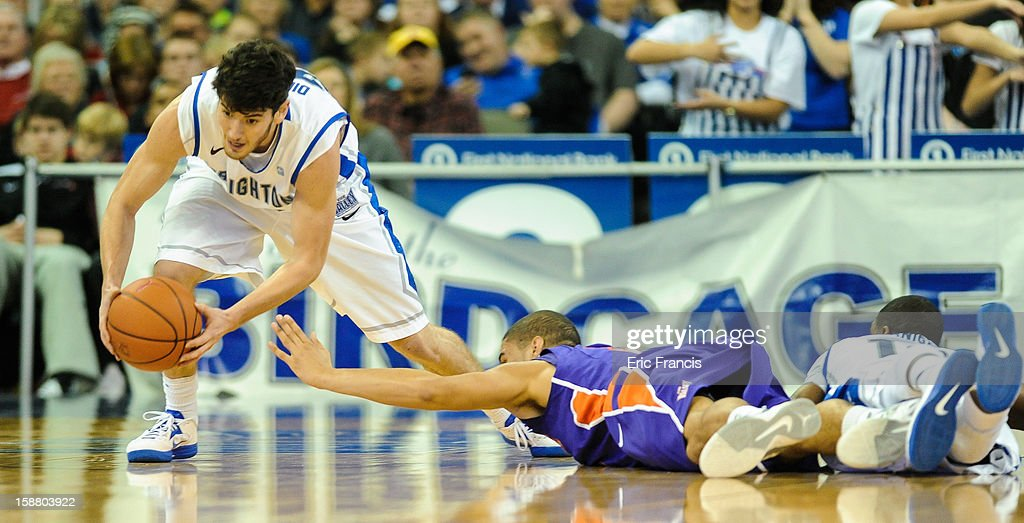 Avery Dingman #22 of the Creighton Bluejays picks up a loose ball from D.J. Balentine #31 of the Evansville Aces during their game at the CenturyLink Center on December 29, 2012 in Omaha, Nebraska. Creighton defeated Evansville 87-70.