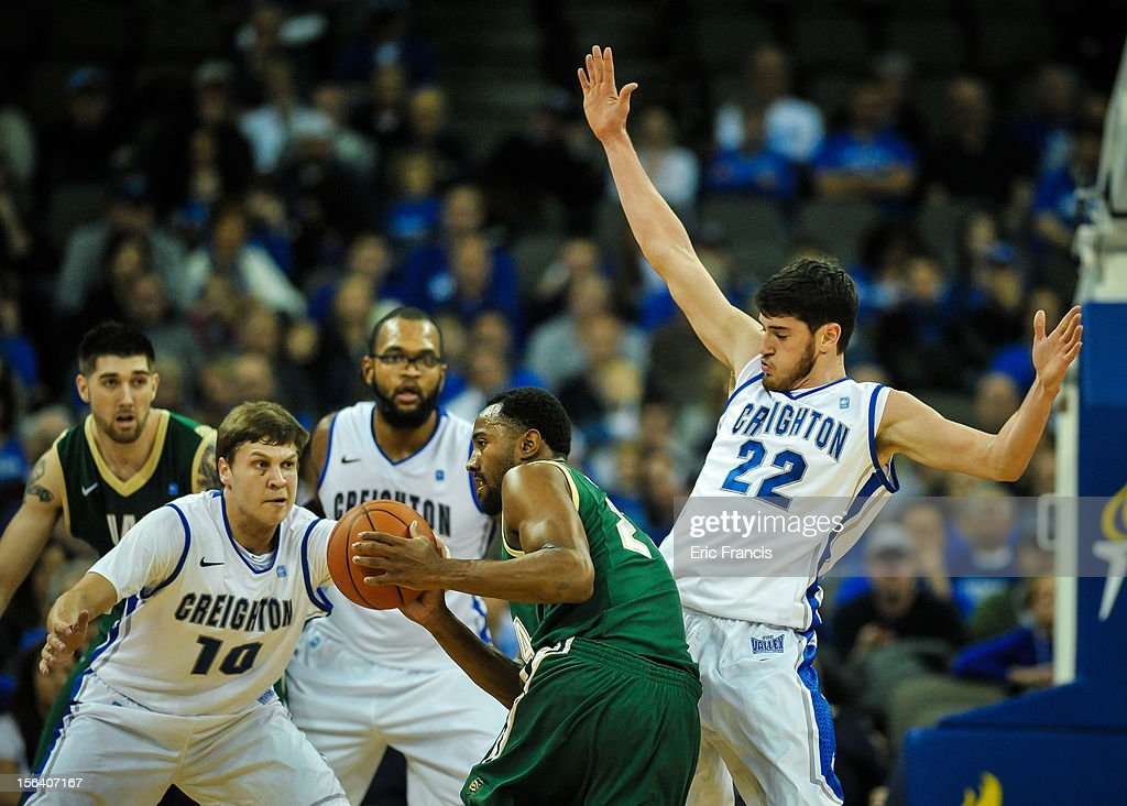 Avery Dingman #22 of the Creighton Bluejays tries to block the progress of Preston Purifoy #24 of the UAB Blazers during their game at CenturyLink Center on November 14, 2012 in Omaha, Nebraska.