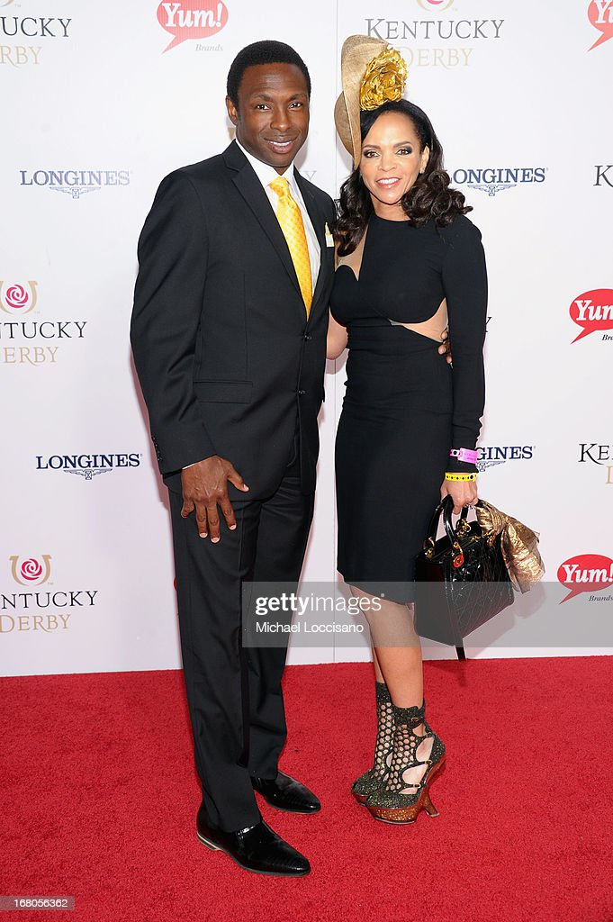 Avery Johnson and Cassandra Johnson attend the 139th Kentucky Derby at Churchill Downs on May 4 2013 in Louisville Kentucky
