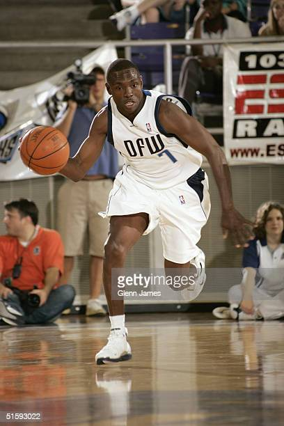 Avery Johnson of the Dallas Mavericks dribbles upcourt during an intrasquad exhibition at the Mavs Fan Jam on October 9 2004 at Texas Christian...
