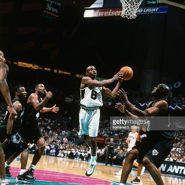 Avery Johnson of the San Antonio Spurs passes against the Minnesota Timberwolves in Game Two of the Western Conference Quarterfinals during the 1999...