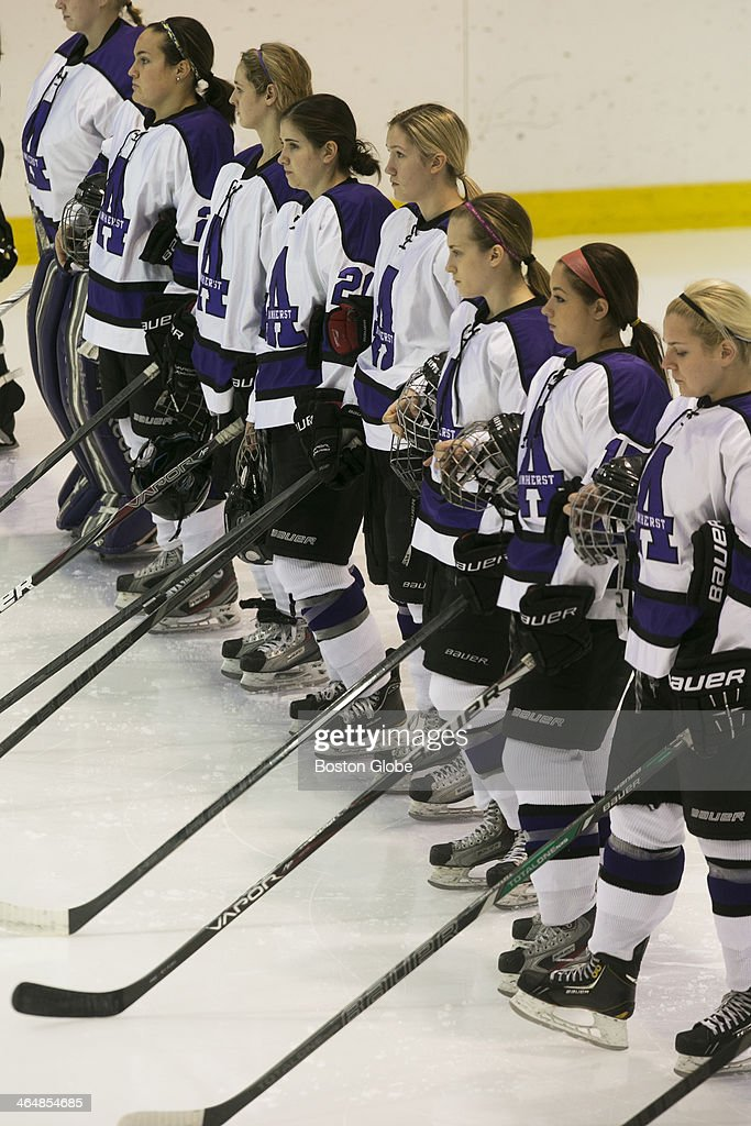 Avery Stone a center for Amherst College third from the right during introductions prior to a game against Cortland at the Orr Rink