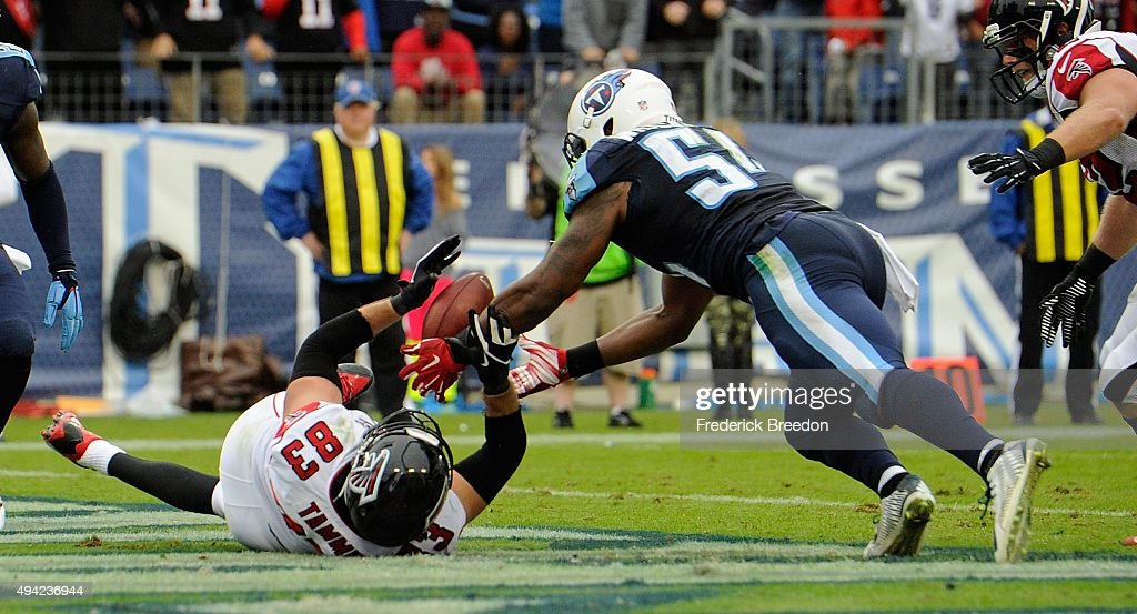 Avery Williamson #54 of the Tennessee Titans makes an interception of a pass intended for Jacob Tamme #83 of the Atlanta Falcons in the end zone during the second half at Nissan Stadium on October 25, 2015 in Nashville, Tennessee.