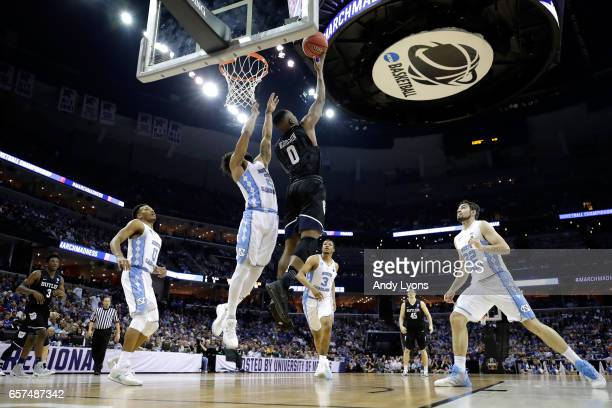 Avery Woodson of the Butler Bulldogs shoots against Joel Berry II of the North Carolina Tar Heels in the second half during the 2017 NCAA Men's...