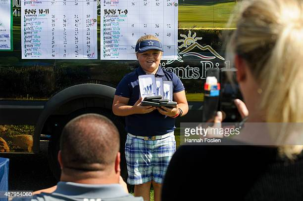Avery Zweig holds up her medals to be photographed at a Regional Finals for 79 year old girls at the Drive Chip and Putt competition on September 12...