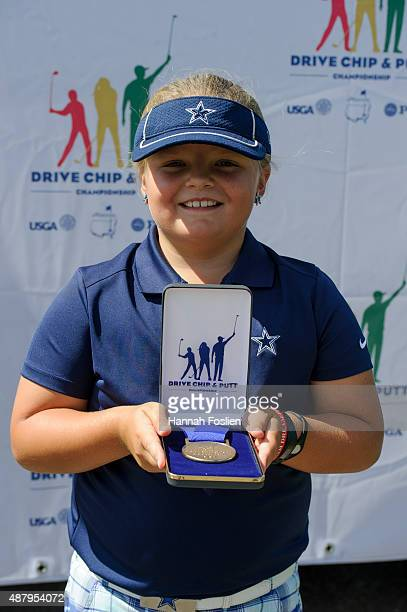 Avery Zweig poses for a photo after winning first place overall t a Regional Finals for 79 year old girls at the Drive Chip and Putt competition on...