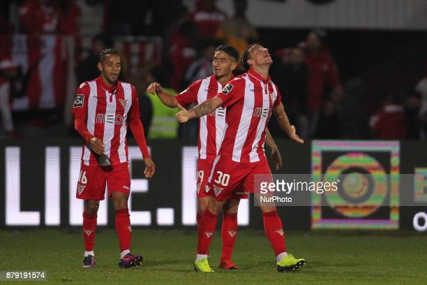 Aves' midfielder Vitor Gomes celebrates with teammates after scoring the equalizer goal during the Portuguese league football match CD Aves vs FC...