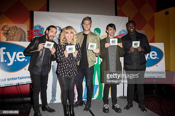 Avi Kaplan Kirstie Maldonado Scott Hoying Mitch Grassi and Kevin Olusola of Pentatonix attend their meet and greet at Planet Hollywood Times Square...